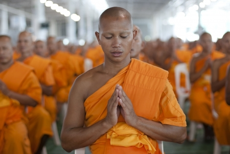 BANGKOK, SEPTEMBER 22. A young Thai Buddhist monk meditates during a mass spiritual event at the Dhammakaya temple north of Bangkok in Thailand on September 22, 2011. The Dhammakaya temple is the largest religious physical structure in the world although