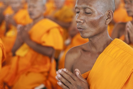 BANGKOK, SEPTEMBER 22. A Thai Buddhist monk meditates during a mass spiritual event at the Dhammakaya temple north of Bangkok in Thailand on September 22, 2011. The Dhammakaya temple is the largest religious physical structure in the world although it is