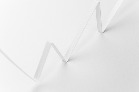 A horizontal image of a white paper graph on a white background photo