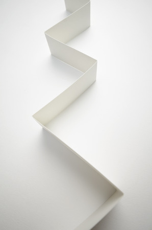 business trending: A vertical image of a white paper graph on a white background photographed with a wide angle lens Stock Photo