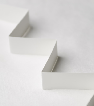 inclination: A vertical image of white paper steps on a white background