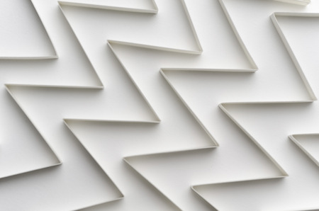 corridors: A horizontal image of white paper graphs making corridors on a white background photographed in a soft focus style