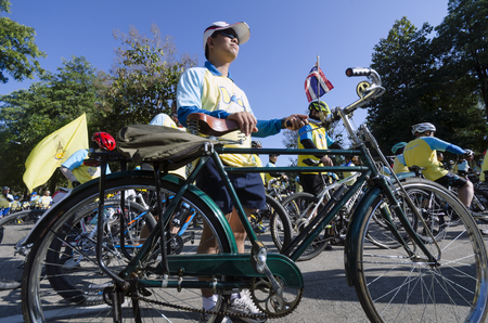 hundreds and thousands: Chiang Mai, Thailand - December 11, 2015: A cyclist waits for the Bike For Dad event to begin on December 11, 2015 in Chiang Mai, Thailand. The Bike For Dad cycling event attracts hundreds of thousands of cyclists and is held across Thailand to celebrate
