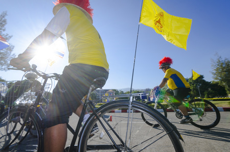 hundreds and thousands: Chiang Mai, Thailand - December 11, 2015: Two cyclists wait for the Bike For Dad event to begin on December 11, 2015 in Chiang Mai, Thailand. The Bike For Dad cycling event attracts hundreds of thousands of cyclists and is held across Thailand to celebrat Editorial