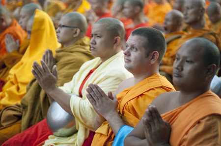 westerner: Chiang Mai, Thailand - December 26, 2015: A western Buddhist monk attends a special alms offering ceremony organized for 10,000 monks by Wat Phra Dhammakaya among Thai monks on December 26, 2015 in Chiang Mai, Thailand. Editorial