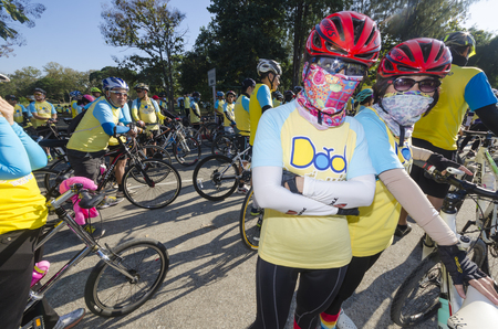 hundreds and thousands: Chiang Mai, Thailand - December 11, 2015: Two women before the Bike For Dad event on December 11, 2015 in Chiang Mai, Thailand. The Bike For Dad cycling event attracts hundreds of thousands of cyclists and is held across Thailand to celebrate the birthday