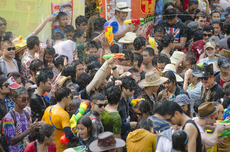 Chiang Mai, Thailand - April 14, 2014: A large group of people take part in the Songkran festival in Chiang Mai, Thailand on April 14, 2014.