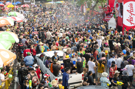 Chiang Mai, Thailand - April 14, 2014: A large group of people gather in front of the Air Asia stage during the Songkran festival in Chiang Mai, Thailand on April 14, 2014.