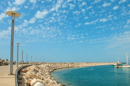 Sunny Mediterranean coastline with blue sky and some clouds Stock Photo