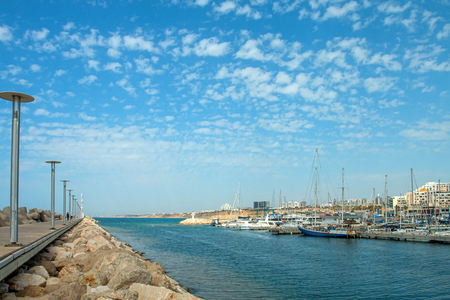 Sunny Mediterranean coastline with blue sky and some clouds Editorial