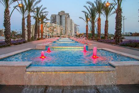 eventide: Ashkelon seaside park fountains colored evening light Editorial