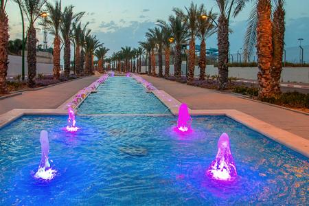 Ashkelon seaside park fountains colored evening light Editorial