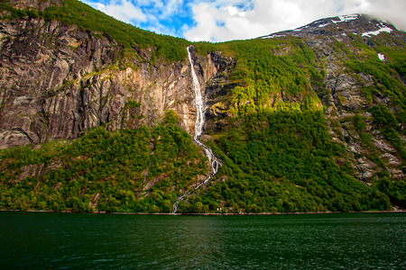 Beautiful and high waterfall. Geiranger fjord, Norway
