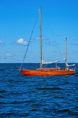 Yacht with lowered sails