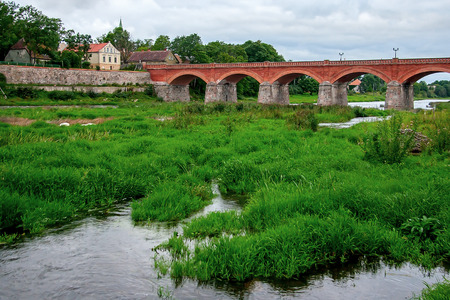 Brick bridge across the River Venta in the city of Kuldiga Stock fotó