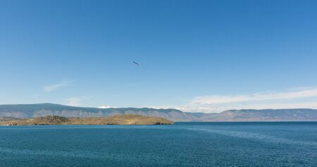 Beautiful view of Lake Baikal on a clear summer day from the shore of Olkhon Island
