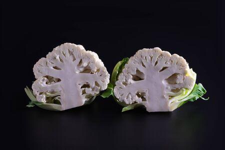 two cauliflowers, broccoli on a black background Reklamní fotografie - 132289445