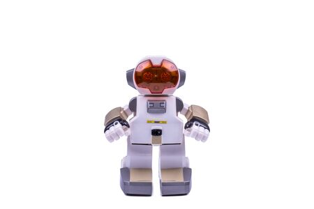 Childrens toy, white robot with an orange helmet on white