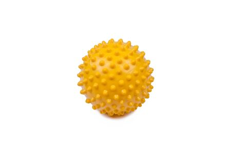 massage ball, color yellow, object isolated, photo on a white background Фото со стока