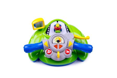 toy, steering wheel for children made of plastic, green, object isolated, white background Фото со стока