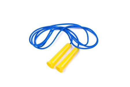 jump rope of blue color with yellow handles, object is isolated, white background Фото со стока