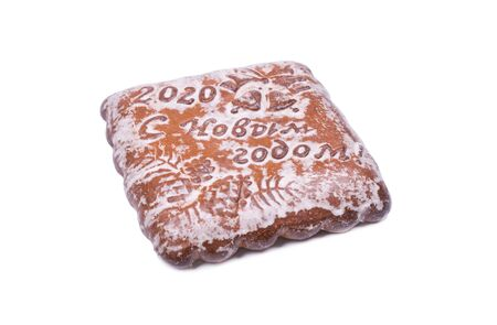 Big Tula gingerbread square-shaped, on the gingerbread the inscription Happy New Year 2020, photo on a white background, object isolated, Фото со стока