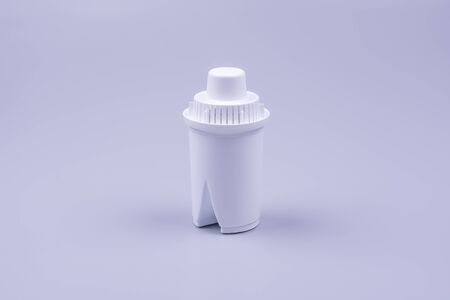 carbon filter for water, white, close-up photo on a gray background