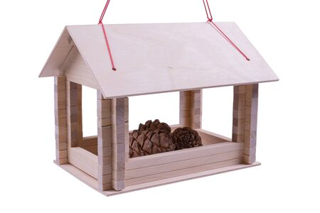 bird feeder with pine cones inside, white background, isolated