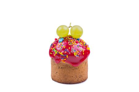 cupcakes with red icing and green grapes on a white background, object isolated