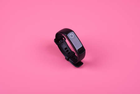 smart watch in black on a pink background, side view Stock fotó
