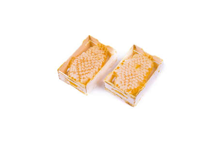 two portions of bee honey in combs and wooden packaging, the object is isolated, the background is white, top view