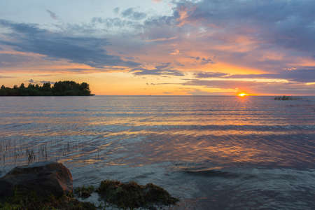 a beautiful sunset on the Rybinsk reservoir, voto made on a calm July evening
