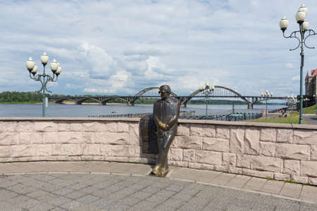 view of the monument to the poet Lev Ashanin, photo was taken on a sunny summer day on the Volga river embankment.