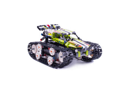 children's tracked all-terrain vehicle, assembled from small parts, object is isolated, background white, side view