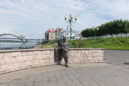 Russia July 1, 2020 Rybinsk, view of the monument to the poet Lev Ashanin, photo was taken on a sunny summer day on the Volga river embankment.