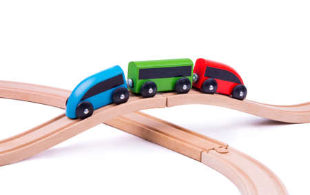 children's toy train made of wood on a wooden bridge, the object is isolated on a white background, side view Stock fotó