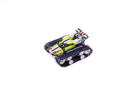 children's tracked all-terrain vehicle, assembled from small parts, the object is isolated, the background is white, top view