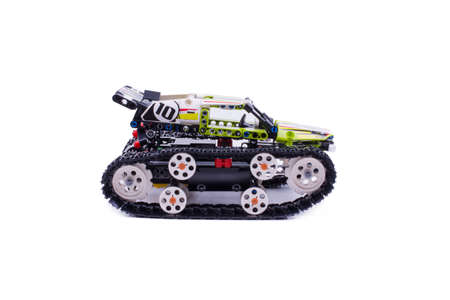 children's tracked all-terrain vehicle, assembled from small parts, the object is isolated, the background is white, side view