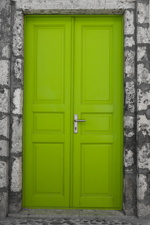 Green door in an old building