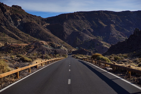 road going into the distance a mountainous landscape Stock Photo