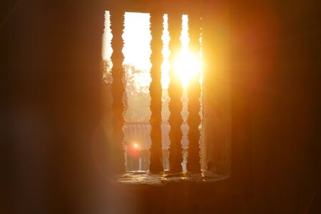 Magic color suns rays light through the window in Angkor Wat