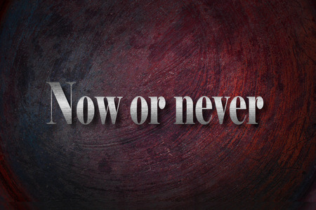 Now or never text on background photo