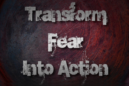 Transform Fear Into Action Concept text on background photo