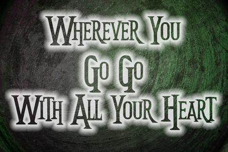 wherever: Wherever You Go Go With All Your Heart Concept text on background Stock Photo