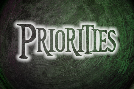 Priorities Concept text on background photo