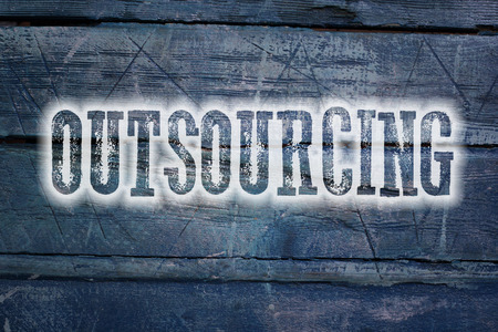 Outsourcing Concept text on background photo