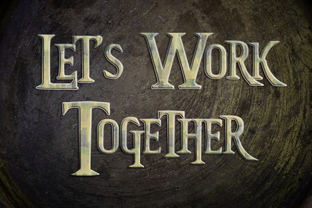 Lets Work Together Concept text on background photo