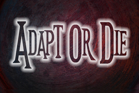 Adapt Or Die Concept text on background photo