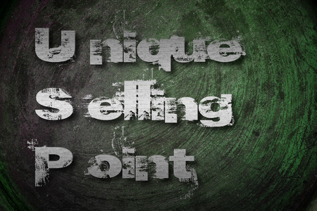 Unique Selling Point Concept text on background photo