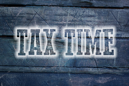 Tax Time Concept text on background photo
